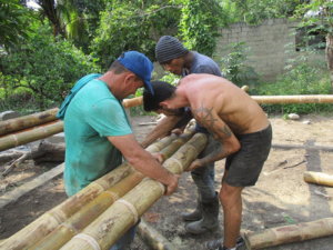 Casa Brujula workers at putting foundation together.